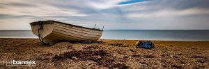 boat on dorset beach